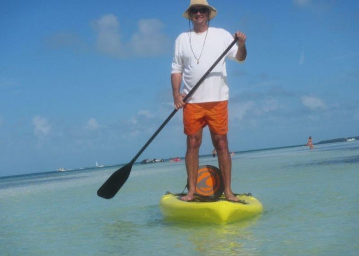 STAND UP PADDLE BOARD IN WHITE SANDY BEACH