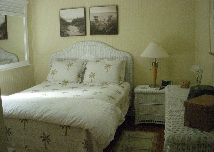 Palms bedroom has queen size bed, bedside table, chest of drawers and closet