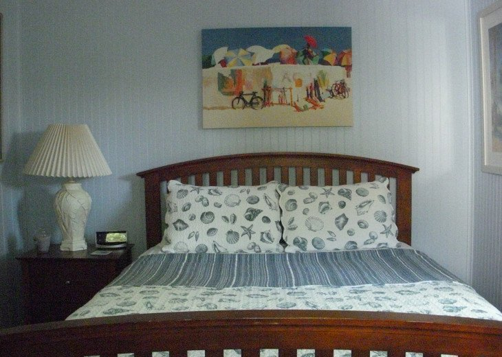 Nautical bedroom has door to the outside patios and tropical shower