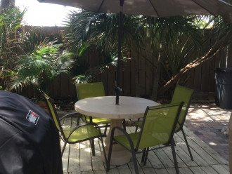 Back deck with umbrella table and 4 chairs