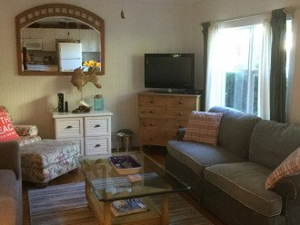 """Living room has ample seating with two couches and club chair plus 32"""" color tv"""
