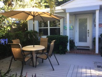 Front patio with umbrella and four chairs