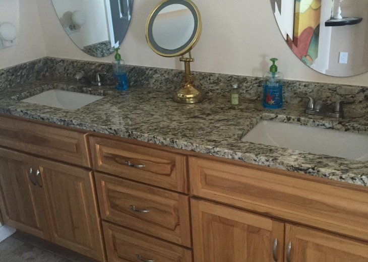 Ensuite Double Sink Vanity with Granite Counters & Hickory Cabinets