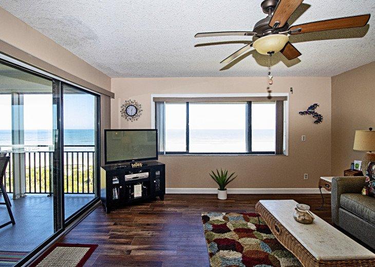 Living room with oceanfront balcony & picture window overlooking Crescent Beach