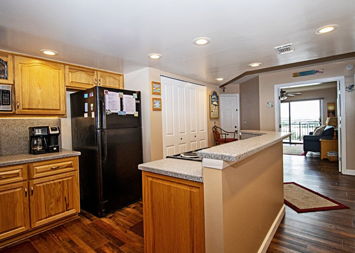 View of Kitchen and French Doors opened to Den and View of Intracoastal Waterway