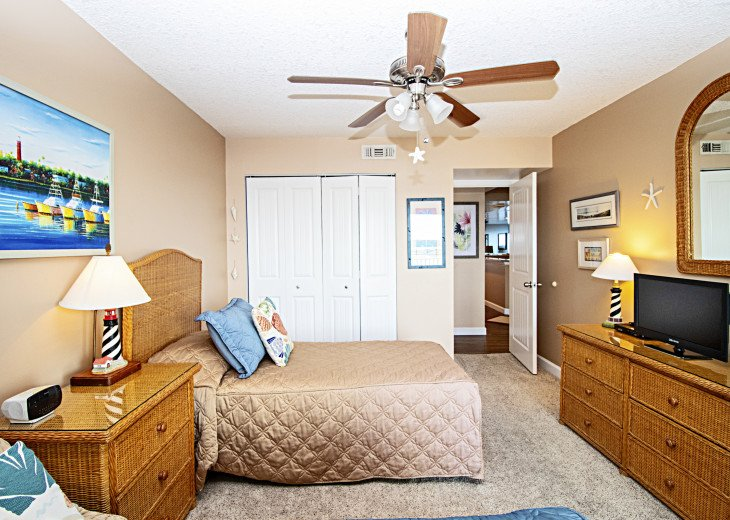 2nd Bedroom with Ceiling Fan, televsions, large closet, upgraded carpet bedding