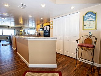 View from Foyer Entrance of Kitchen with Luxury Vinyl Plank Flooring