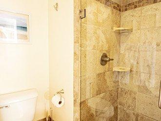 ADA Comfort Height Toilet & Seamless Door Tiled Shower Private Lavatory