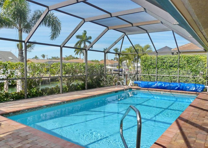 ~ Spacious Waterfront 4 Bedroom with Large Heated SW Facing Pool ~ #24
