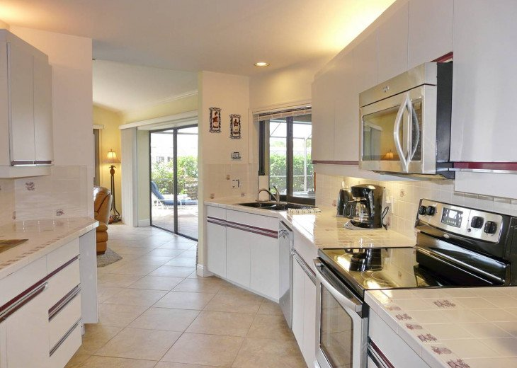 ~ Spacious Waterfront 4 Bedroom with Large Heated SW Facing Pool ~ #13