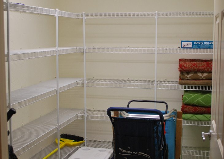 Pantry area. Filled with beach toys, chairs, cart, towels. Also DVDs