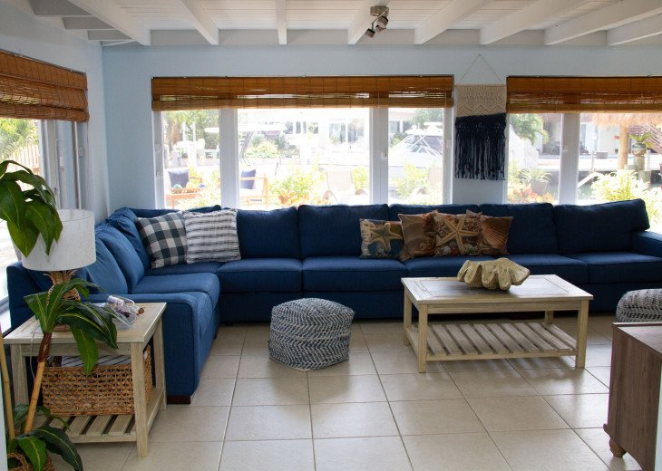 Living area opens to back yard; pull out couch (1 of 2)