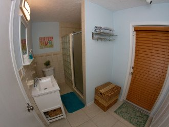Master Bathroom with walk in shower and door to outdoor covered patio