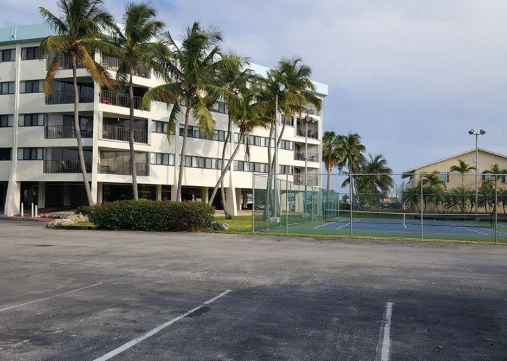 Tennis courts and extra parking right by the Tower Building where the condo is