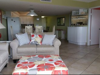 View of kitchen dining and entry form living room! Also nice bar area!