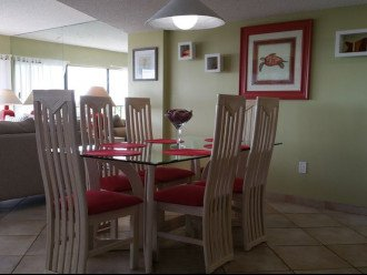 Dining area has seating for 6, plus 3 at kitchen bar!