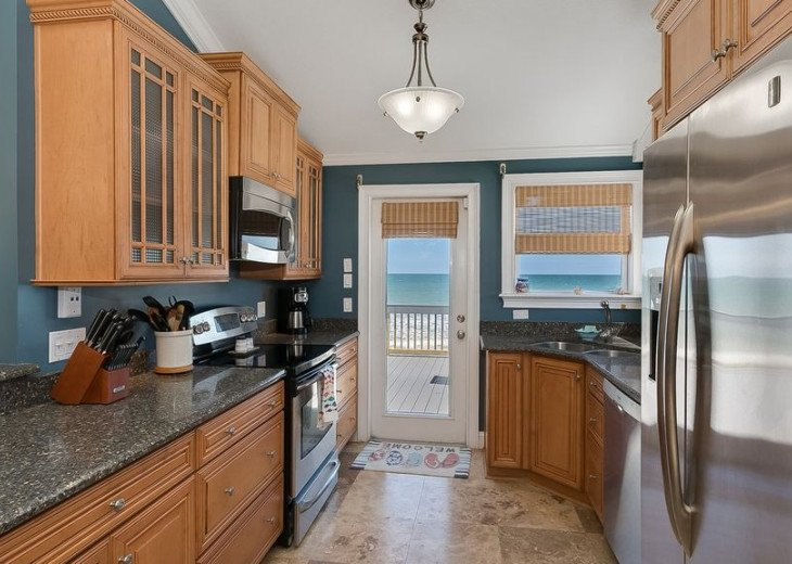 3 bedroom, 2 bath, pet friendly home located right on the beach. Fenced yard. #4