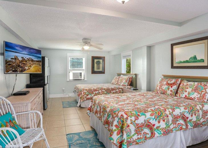 Two queen beds in bonus room (window AC unit)