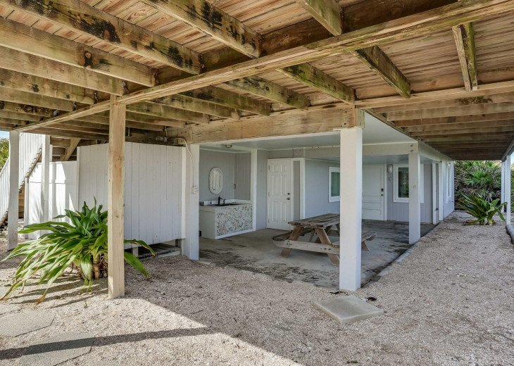 Covered area under the deck. The door on the right leads to the bonus room