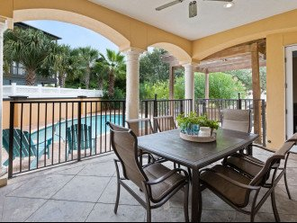 1st floor gated patio overlooking pool