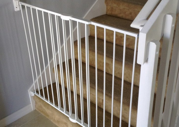Child safety gate fitted at bottom of stairs