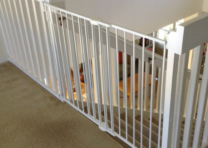 Child safety gate fitted at top of stairs