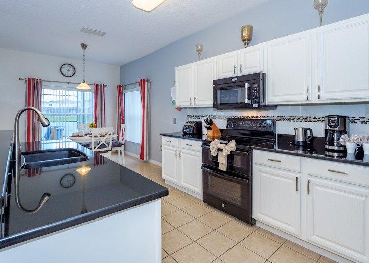 Modern kitchen with views to breakfast nook
