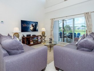 """Comfy lounge with 65"""" Samsung TV"""