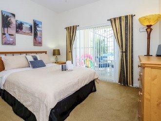 Downstairs Queen bedroom with doors onto pool deck