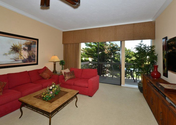 Family Room with flat screen TV and pull-out sofa bed.