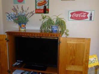 kid'es living room with TV, WII console, games