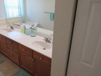 master bath sinks and door of linen closet