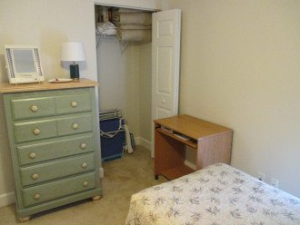 3rd BR closet with 5 drawer chest and small rolling desk