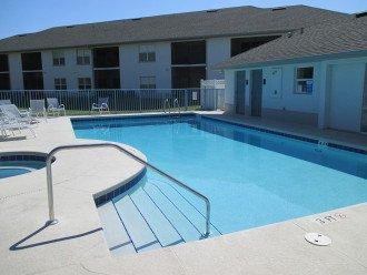 hot tub to left of community solar heated pool