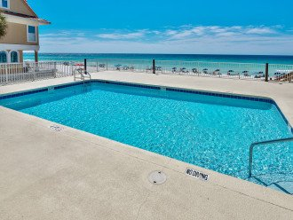 Private pool directly on the beach. This is your beach access with restrooms.