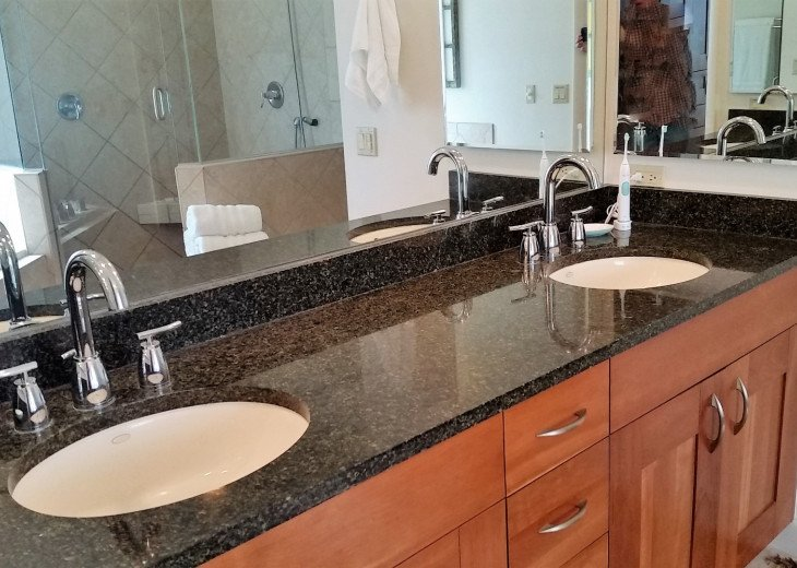Double vanity in master with high-end fixtures and cabinetry.