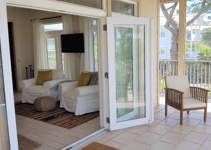 Master suite flows onto private screened porch.