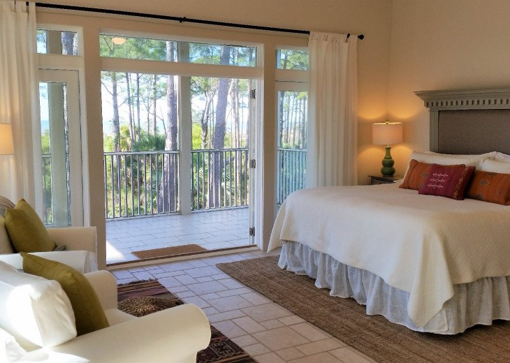 Master suite with seating area and private screened porch with wonderful view.