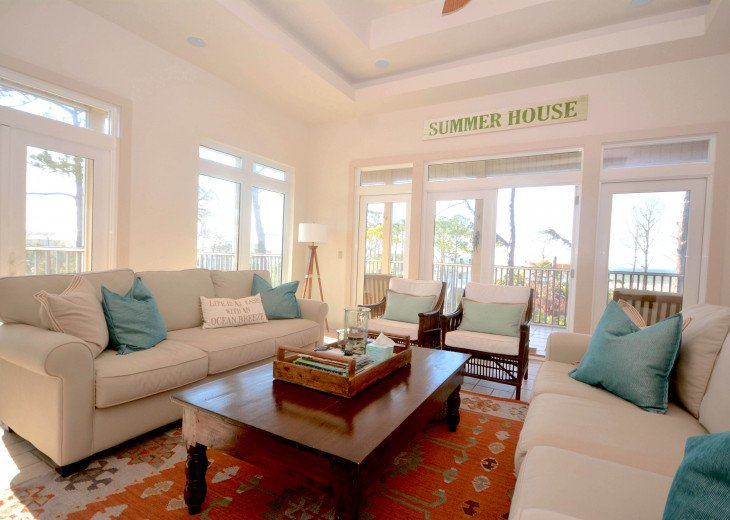 Living room has ample eating and excellent views of Gulf and beaches.
