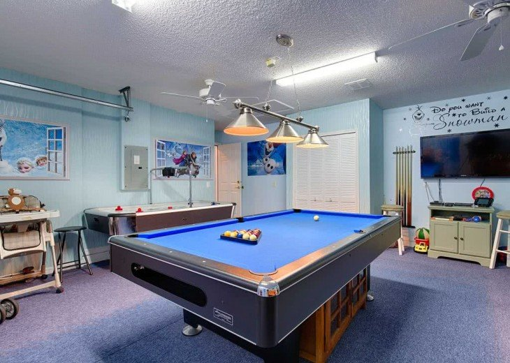 Slate bed pool table, air hockey, foosball, 55 inch TV with Wii and Playstation