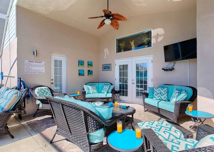 Relax in the poolside living area - comfortable seating and 42 inch TV