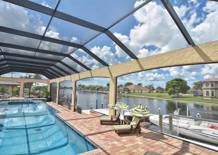 Caribbean Island Dolphin View - 54 ft log pool/ spa, dock 2 min. to the river #77