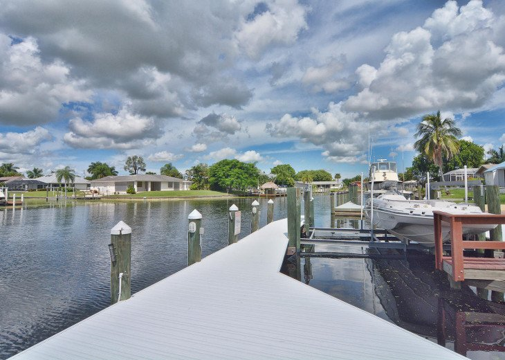 Caribbean Island Dolphin View - 54 ft log pool/ spa, dock 2 min. to the river #32
