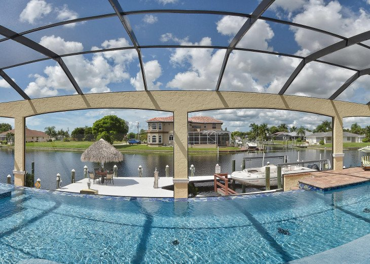 Caribbean Island Dolphin View - 54 ft log pool/ spa, dock 2 min. to the river #85