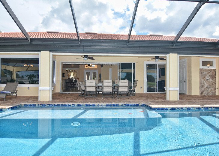 Caribbean Island Dolphin View - 54 ft log pool/ spa, dock 2 min. to the river #66