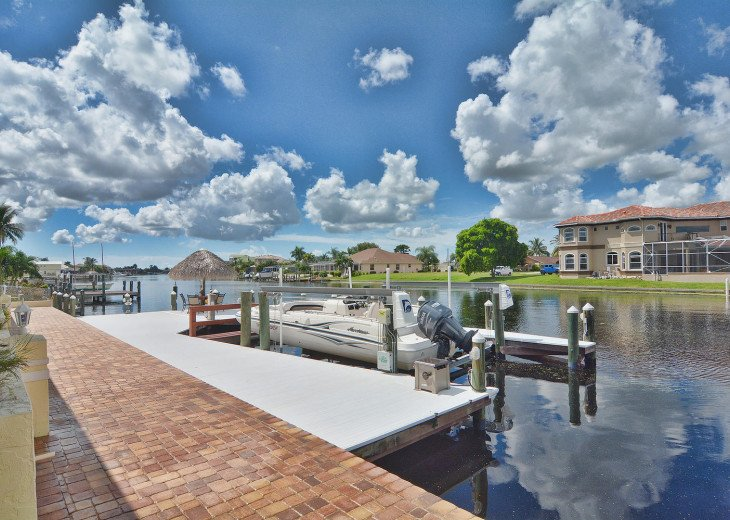 Caribbean Island Dolphin View - 54 ft log pool/ spa, dock 2 min. to the river #81