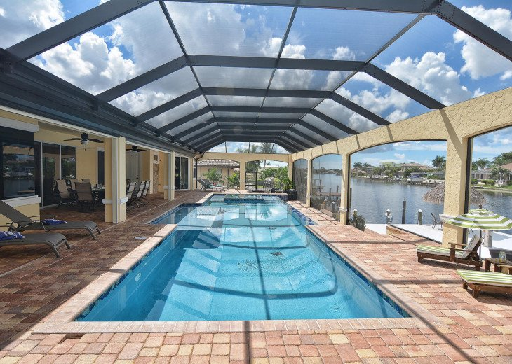 Caribbean Island Dolphin View - 54 ft log pool/ spa, dock 2 min. to the river #58