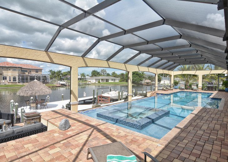 Caribbean Island Dolphin View - 54 ft log pool/ spa, dock 2 min. to the river #80
