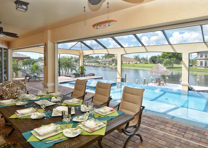 Caribbean Island Dolphin View - 54 ft log pool/ spa, dock 2 min. to the river #79