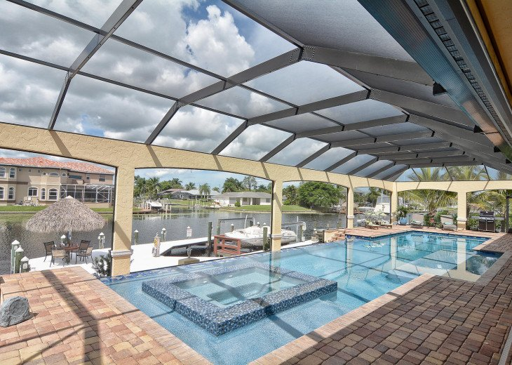 Caribbean Island Dolphin View - 54 ft log pool/ spa, dock 2 min. to the river #69